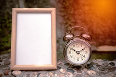 Frame and retro clock in nature. Background Royalty Free Stock Photos