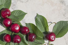 Frame with ripe cherries , the lower left corner. Background, banner for print or web use royalty free stock images