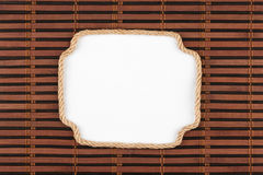 Frame of rope lying on a bamboo mat with a white background  for your text Royalty Free Stock Photos