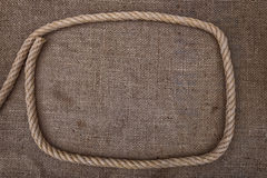 Frame of rope on sackcloth. Stock Photos