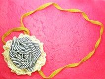 Frame Of Rose Fabric Handmade Decoration. Beautiful Frame Of Rose Fabric Handmade Decoration On Pink Background Royalty Free Stock Photo