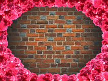 Frame from roses and background from red brick wall Stock Photo