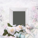 Frame, roses, doves, wedding rings, photo album on a romantic vintage background Stock Images