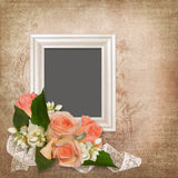 Frame with roses on an old vintage background Royalty Free Stock Photos