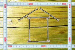 Frame with a ruler and a lodge from bolts inside Stock Photo