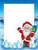 Frame with Santa and Christmas gift Royalty Free Stock Photo