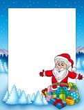 Frame with Santa and pile of gifts Stock Photography