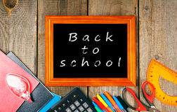 Frame and school tools. Vertically. Royalty Free Stock Photos