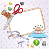 Frame with scissors, a pillow, a pin, buttons, threads. Stock Image