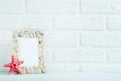 Frame of sea shells. On the brick wall background Royalty Free Stock Photography