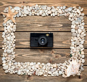 Frame from sea shells and stones Royalty Free Stock Photography