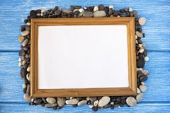 Frame of sea stones on a blue background design stock photography