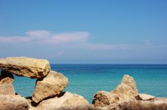 Frame on the sea. Stones frame in Pianosa Island in front of Elba Island, Tuscany, Italy Royalty Free Stock Images