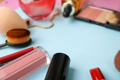 Frame from a set of female cosmetics from a lipstick, a highlighter, a pencil for lips, brushes, brushes, perfume, powder stock photo