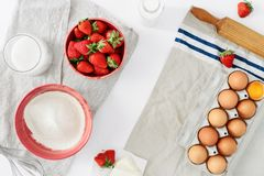 Frame set ingredients cooking strawberry pie cake white backgrou. Frame of set ingredients for cooking strawberry pie or cake on white background. Flat lay, top Royalty Free Stock Photography