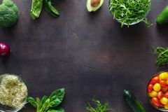 Frame from set of ingredients for detox salad. On dark background. Broccoli, spinach, avocado, arugula, pea shoots, alfalfa, onion, tomatoes and cucumber on Royalty Free Stock Photo