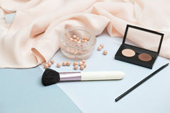Frame from set of professional decorative cosmetics. Makeup tools and accessory on blue background with copy space for your text. flat lay frame composition Stock Photo
