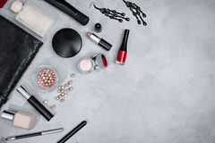Frame from set of professional decorative cosmetics. Makeup tools and accessory on concrete gray background with copy space for your text. flat lay frame Royalty Free Stock Photo