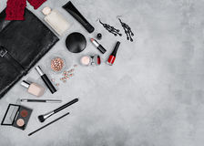 Frame from set of professional decorative cosmetics. Makeup tools and accessory on concrete gray background with copy space for your text. flat lay frame Stock Images