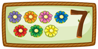 A frame with seven flowers Stock Images