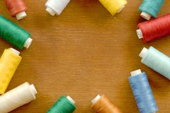 Frame of sewing thread spools. Of different colors stock photo