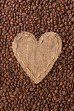 Frame in the shape of heart made of burlap with coffee beans Stock Photos