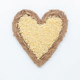 Frame in the shape of heart with millet Stock Images