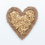Frame in the shape of heart with  oats Royalty Free Stock Image