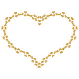 Frame in the shape of heart of small gold hearts Stock Photos