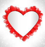 Frame in the shape of a heart for text with red air balls on gra Stock Photos