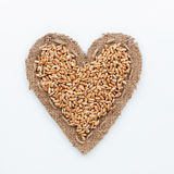 Frame in the shape of heart with wheat Royalty Free Stock Photos