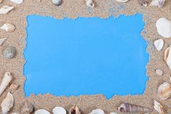 Frame of shells and sand on blue royalty free stock images