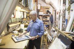 Frame shop owner. In New York City royalty free stock image