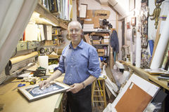 Frame shop owner. In New York City stock photos