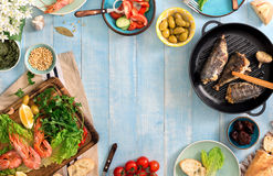 Frame of shrimp, fish grilled, salad and different snacks Royalty Free Stock Photography