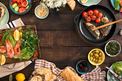 Frame of shrimp, fish grilled, salad and snacks Stock Photography