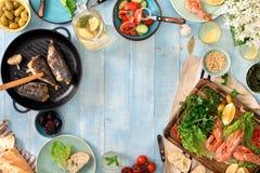 Frame of shrimp, fish grilled, salad, snacks and homemade lemona Royalty Free Stock Image