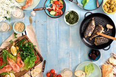 Frame of shrimp, fish grilled, salad, snacks and lager beer Royalty Free Stock Photography