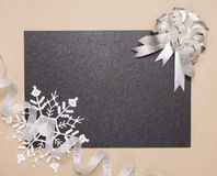 Frame with silver bow and snowflake Royalty Free Stock Photos