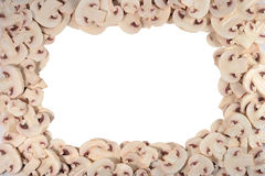 Frame of sliced mushrooms on a white Royalty Free Stock Photo