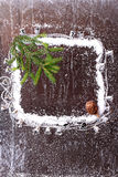 Frame of the snow with a Christmas tree and a bump on a dark wooden background snowy winter brochure. Frame of the snow with a Christmas tree and a bump on a stock image