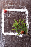 Frame of the snow with a Christmas tree and a bump on a dark wooden background snowy winter brochure. Frame of the snow with a Christmas tree and a bump on a stock images