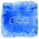 Frame of snowflakes on a blue watercolor background stock illustration