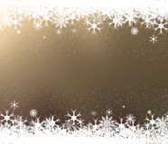 Frame of snowflakes on brown background Stock Images