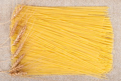 Frame of spaghetti and ears of wheat Royalty Free Stock Photos