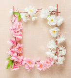 Frame of spring flowers on a wooden ,with space for text ,spring or summer theme Stock Photo
