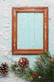 Frame with spruce branches on an old wooden board painted Royalty Free Stock Image