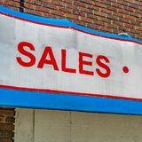 Frame Square Close up of building exterior with a huge sign that reads Sales Service Parts. The old building has brick wall and the windows have white frames royalty free stock photos