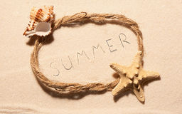 Frame with starfish, empty seashell and summer on sand Stock Photo
