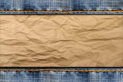 Frame of stitched blue jeans on cardboard Royalty Free Stock Photos